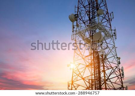 Satellite dish telecom network at sunset communication technology network - stock photo