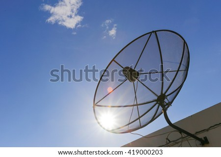 Satellite dish to the sky in blue sky background with tiny clouds - stock photo