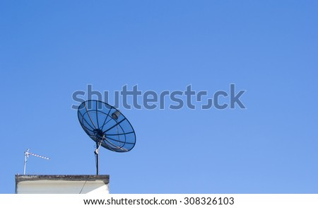 Satellite dish transmission data with blue sky background. - stock photo