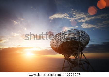 satellite dishes antenna with sunset - stock photo