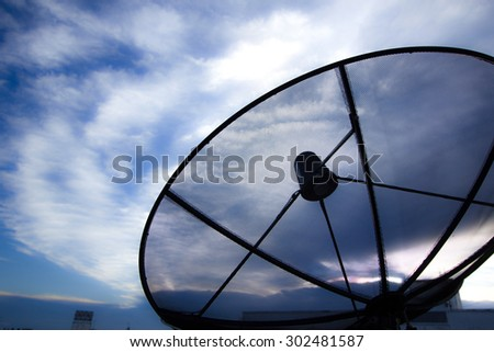Satellite dishes communication technology network with cloud in sky background - stock photo