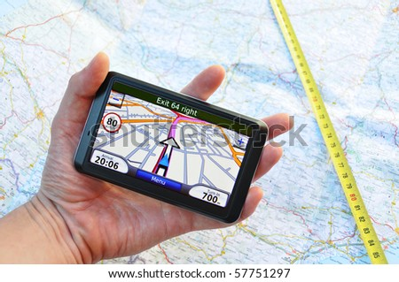Satellite navigation system in the hand - stock photo