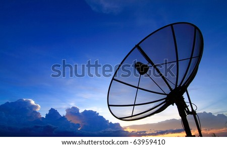 Satellite TV with sunset sky - stock photo