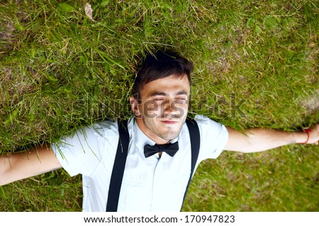 Satisfied smiling young male outdoors - stock photo