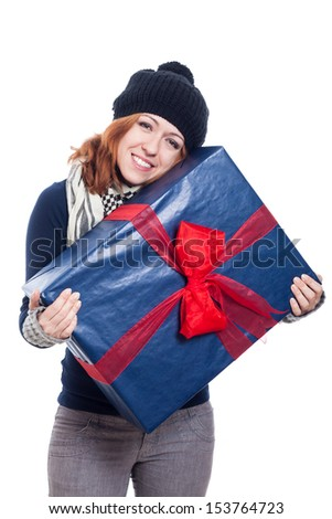 Satisfied winter woman holding big present, isolated on white background. - stock photo