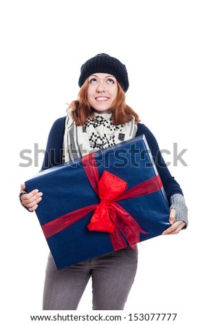 Satisfied woman holding big present and looking up, isolated on white background. - stock photo