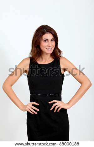 Satisfied woman with hands on hips - stock photo