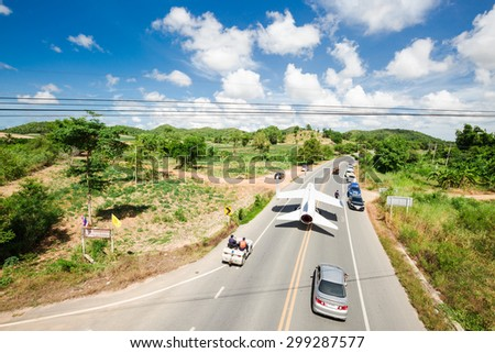SATTAHIP CHONBURI - JULY 23,2015 :The Royal Thai Navy Airforce are working on highway That transportation the old useless A-7 fighter airplane to set in new museum.THAILAND JULY,23 2015 - stock photo