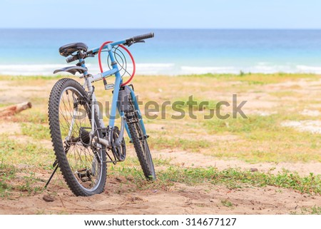 SATTAHIP CHONBURI - SEPTEMBER , 9 : Parked bicycles on the beach in summer.The weather is very good for bike and relax. THAILAND SEPTEMBER,9 2015 - stock photo