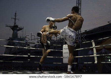 SATTAHIP, THAILAND- APRIL 6 : Between the punch  in Thai Fight : Muay Thai..World's  between Saiyok Pumpanmuang VS Chanajon P.K.Sanchai Muay Thai Gym on April 6, 2014 , Chonburi , Thailand - stock photo