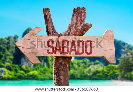 Saturday (in Spanish and Portuguese) arrow with beach background - stock photo
