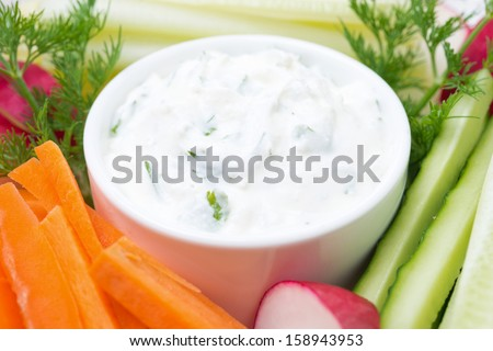 sauce with feta cheese and assorted vegetables close-up, horizontal - stock photo