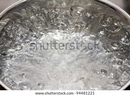 Saucepan full of boiling water - stock photo
