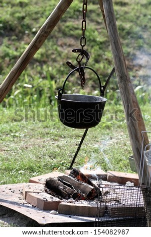 saucepan over a bonfire - stock photo