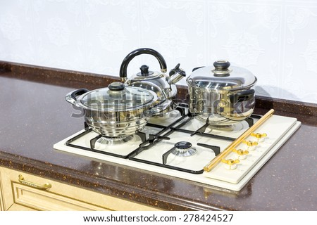 Saucepans on the stove  - stock photo