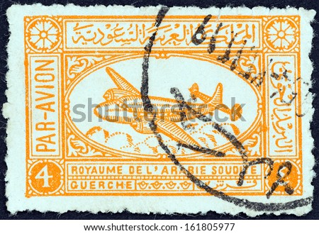 SAUDI ARABIA - CIRCA 1949: A stamp printed in Saudi Arabia shows an airliner, circa 1949.  - stock photo