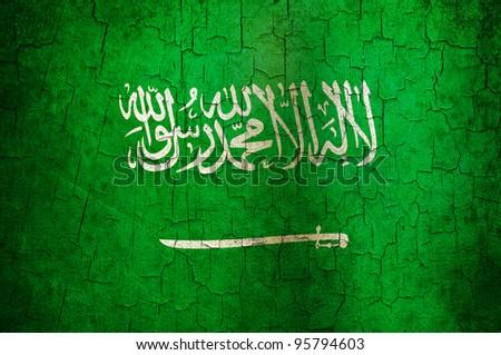 Saudi Arabian flag on a cracked grunge background - stock photo