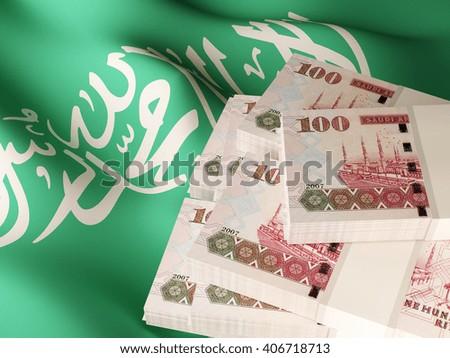 Saudi Riyal banknote bundles on textile textured Saudi Arabian flag. 3d illustration. - stock photo
