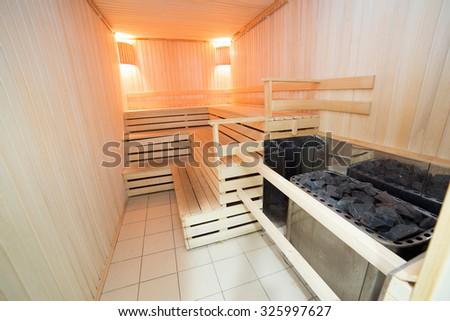 Sauna interior wooden bath room relaxation - stock photo