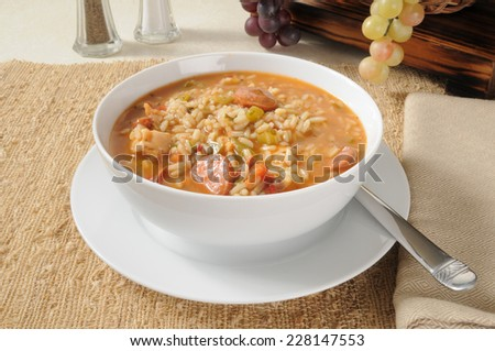 Sausage and chicken gumbo with rice in a bowl - stock photo
