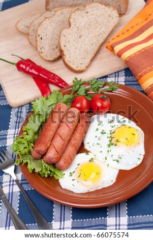 sausage, cayenne and knife on a wooden cutting board. - stock photo