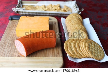 Sausage cheese and  crackers background - stock photo