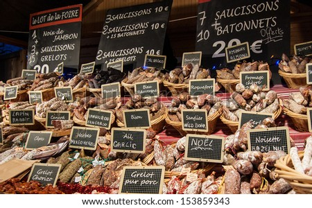 Sausage on a market stand. Christmas market in Paris. - stock photo