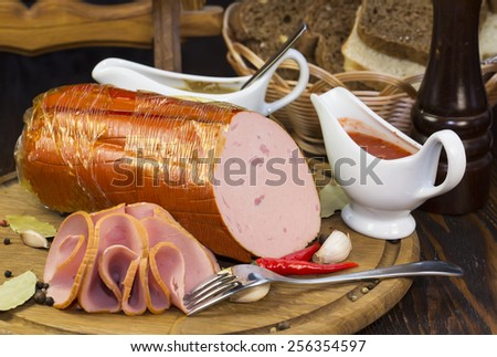 sausage on a wooden plate in a restaurant - stock photo