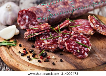sausage on a wooden table - stock photo