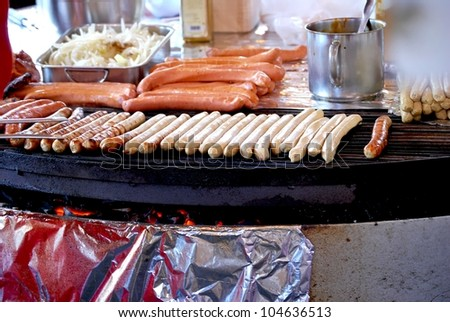 Sausages on grill - stock photo