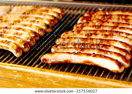 Sausages on the grill - stock photo