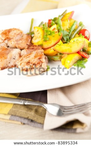 Sauteed Chicken Thights Served with Vegetables - stock photo