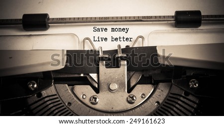 save money live better on typewriter  - stock photo