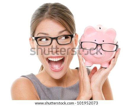 Save money on glasses eyewear. Woman happy and excited over savings on buying eyewear glasses. Piggybank and woman wearing glasses isolated on white background. - stock photo