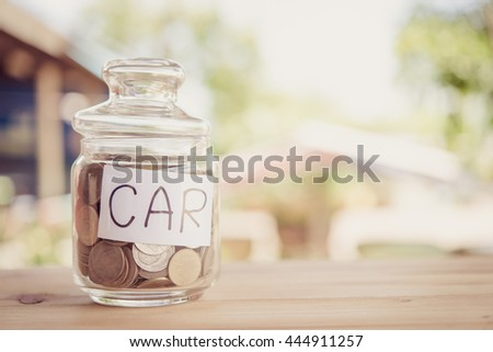 save money,save money concept,save money in glass money jar with car label. - stock photo