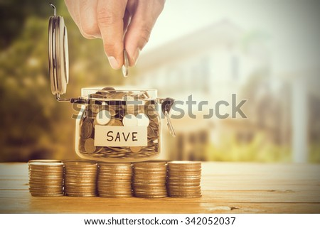 Save money with stack money coin for growing your business  - stock photo