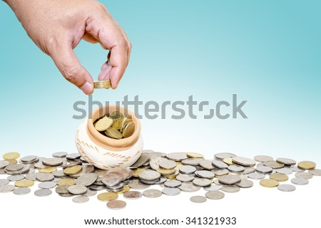 Save money with stack money with blue and white color background. Focusing on money. - stock photo