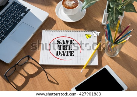 SAVE THE DATE  open book on table and coffee Business - stock photo
