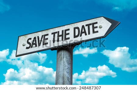 Save the Date sign with sky background - stock photo