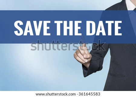 Save The Date word on virtual screen touch by business woman blue background - stock photo
