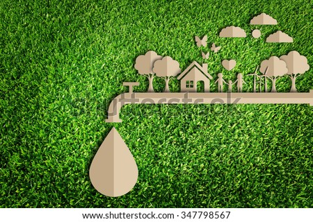 Save water concept.  Paper cut of eco on green grass. - stock photo