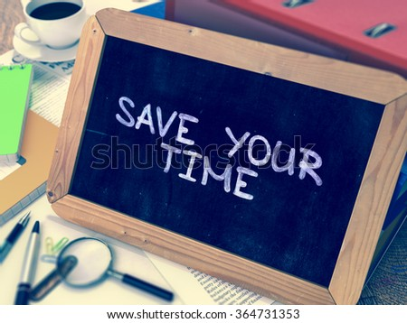 Save Your Time - Chalkboard with Hand Drawn Text, Stack of Office Folders, Stationery, Reports on Blurred Background. Toned 3d Image. - stock photo