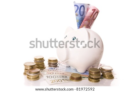 Saving concept - Piggy bank with euro banknotes and coin stacks - stock photo
