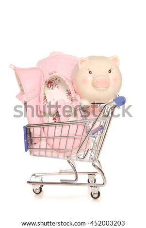 Saving for a baby girl piggybank cutout - stock photo
