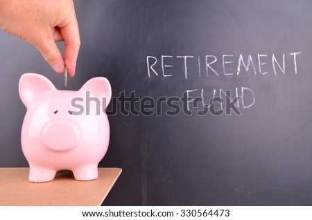 Saving for Retirement in a Pink Piggy bank - stock photo