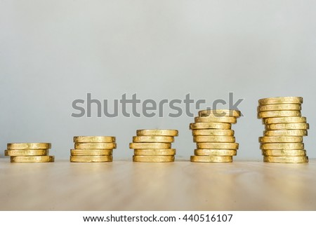 Saving money concept, gold coin stack growing business  - stock photo