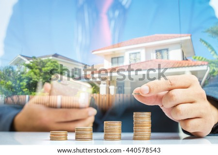 Saving money concept,Investment,Business man hand putting money coin stack growing business,Save Money For buy a house - stock photo