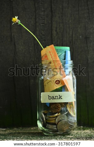 Saving Money Concept With Bank Text Written Label On Glass Jar.Selective Focus And Shallow DOF. - stock photo