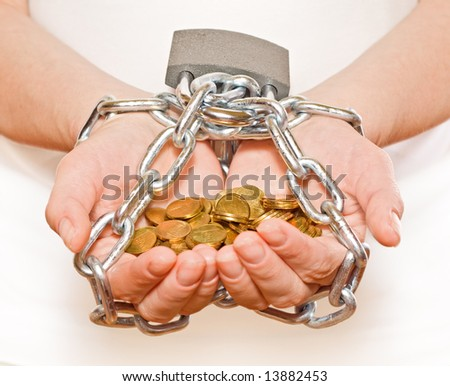 Saving money concept - woman hands with golden coins, chained and locked - stock photo