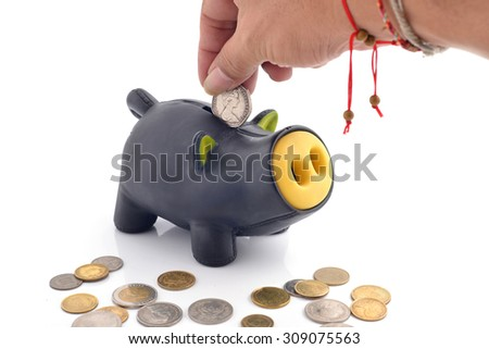 saving money, hand is putting coin into piggy bank isolated on white - stock photo